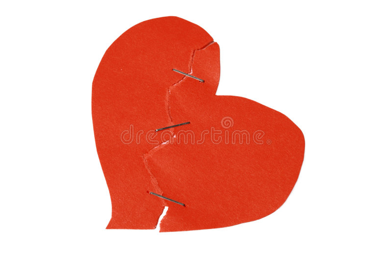 Broken and restored heart. On white background royalty free stock photography