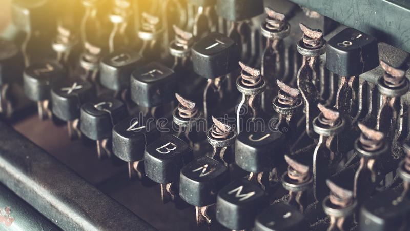 Broken rusty old metal typewriter keys, outdated technology stock photo