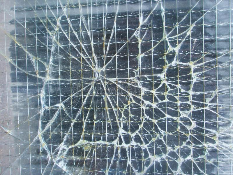 Broken safety wire glass background stock images