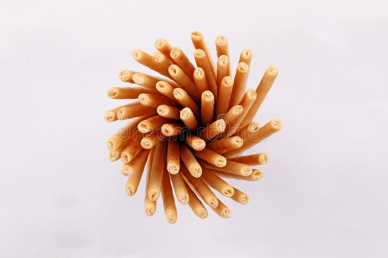 Broken salty bread stick isolated. Broken salty bread stick crumbs on white background isolated top view royalty free stock images