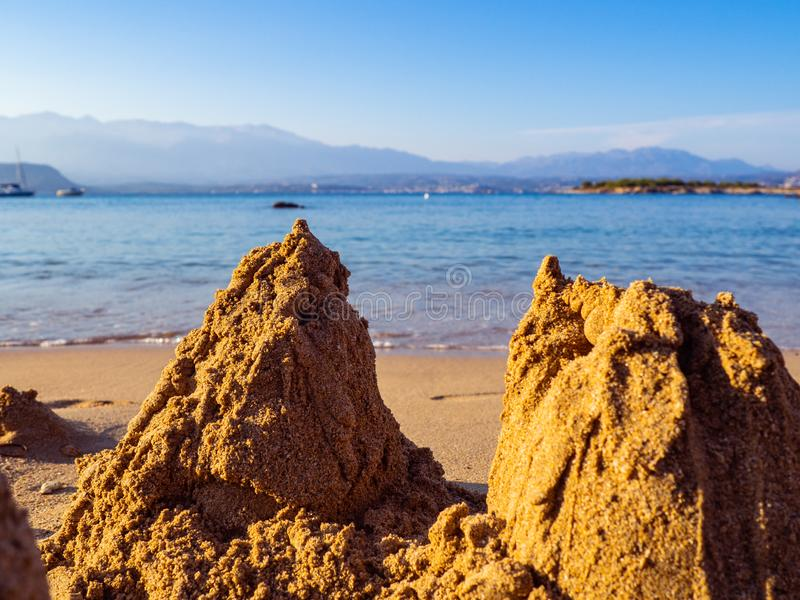Broken sand castles on a empty sand beach stock photography