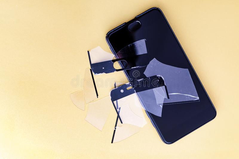 Smartphone with screen protect glass cover in colored background. Broken screen protector and smart mobile phone. Smartphone with screen protect glass cover in royalty free stock photography
