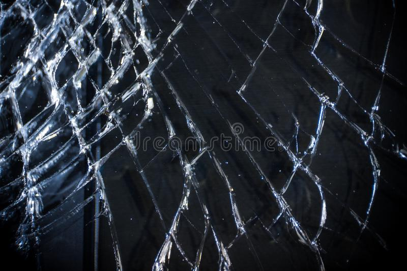 The broken screen of the smartphone close up, you can see the cracks of the glass and shards.  royalty free stock photos