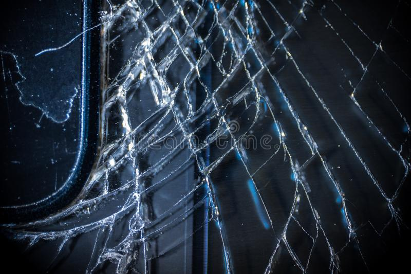 The broken screen of the smartphone close up, you can see the cracks of the glass and shards.  royalty free stock photography