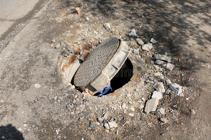 Broken sewer on the road. Danger of injury. Repair of communications.  stock images