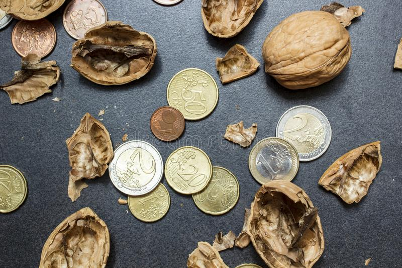 Broken shell of walnut, euro coins and cents. The concept of making money. Close-up.r royalty free stock photo