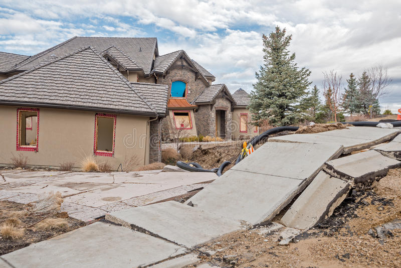 Broken sidewalk and home from Boise landslide. Foothills slide area with damaged home and sidewalk stock image