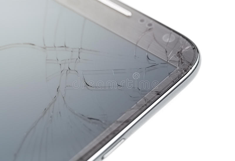 Broken smart phone. Close up of broken smart phone isolated on white background royalty free stock image