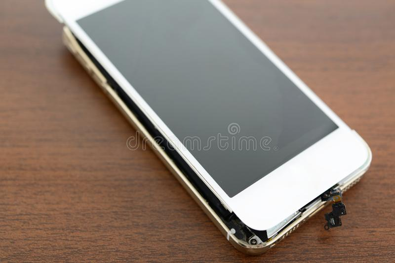 Broken smart phone. On the desk royalty free stock photos