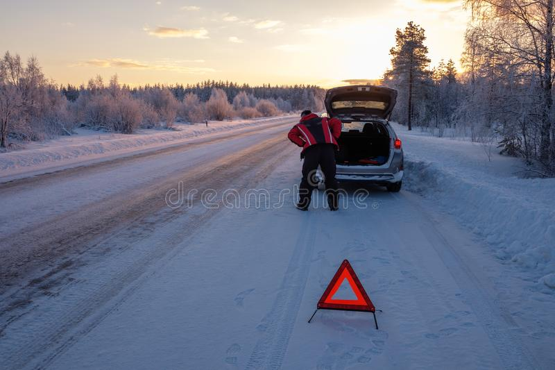 Broken on a snowy winter road royalty free stock images