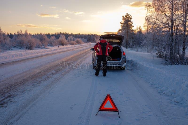 Broken on a snowy winter road stock photo