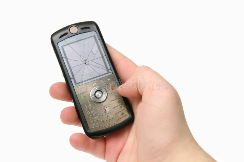 broken sprucken telefon för skärmhandmobil arkivbilder