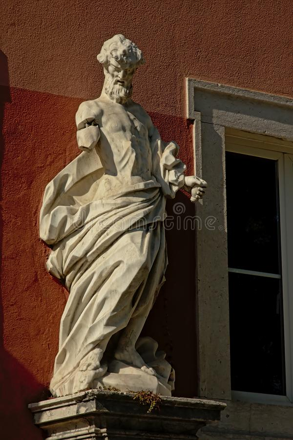 Broken statue of an apostle royalty free stock photography
