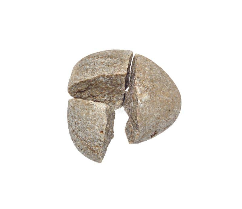 Broken stone. A broken stone in three pieces stock image