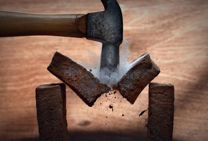 Broken stone. Smashing a stone with a hammer royalty free stock photography
