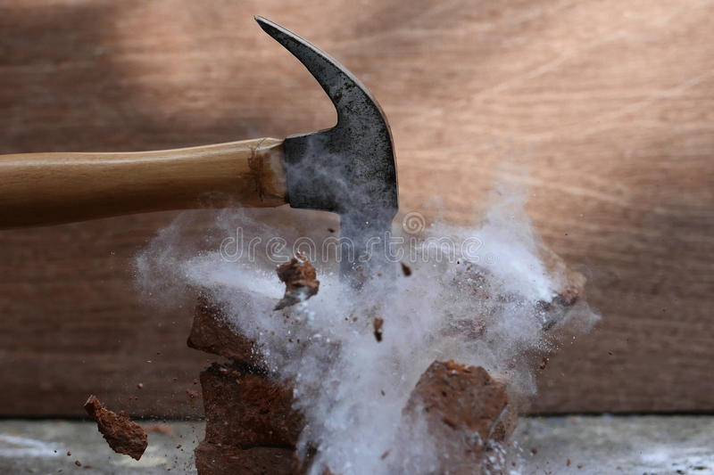 Broken stone. Smashing a stone with a hammer royalty free stock photo