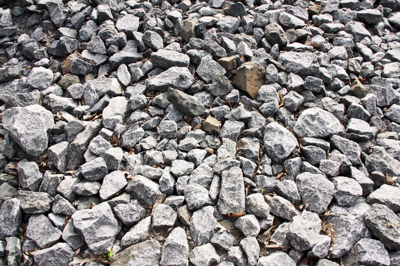 Broken stones pattern. In a raw background royalty free stock photography