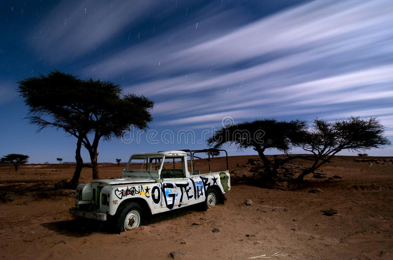 Broken stranded off-road vehicle by night stock photography