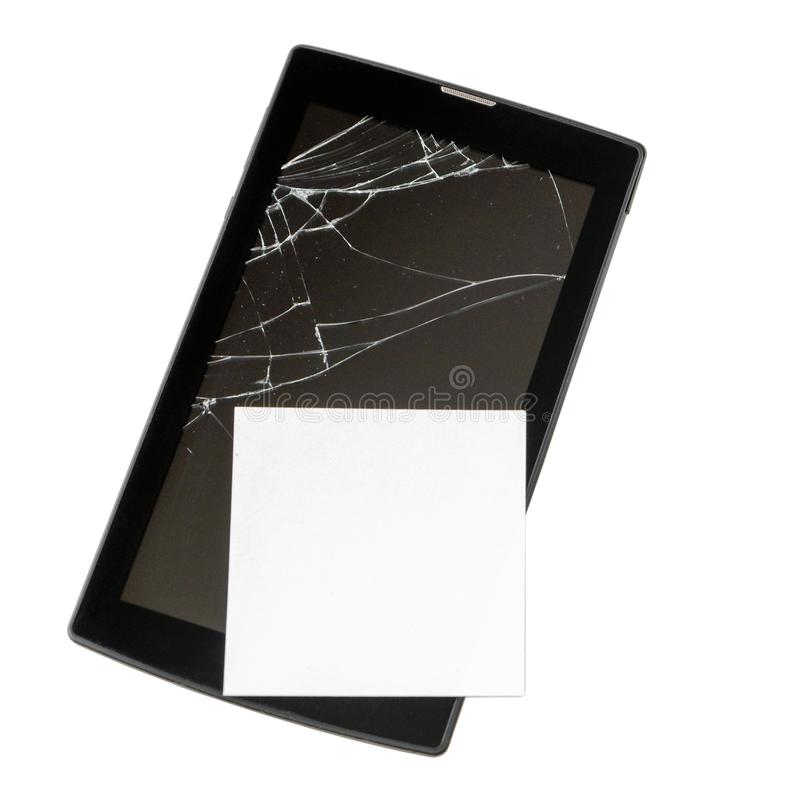Broken tablet computer with cracked screen, with clean sheet of paper isolated on white background.  royalty free stock photography