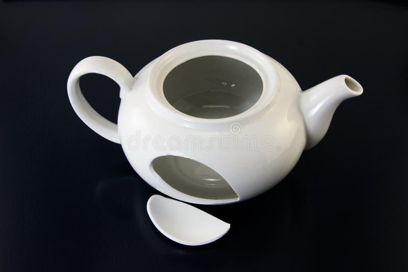 Broken teapot stock image