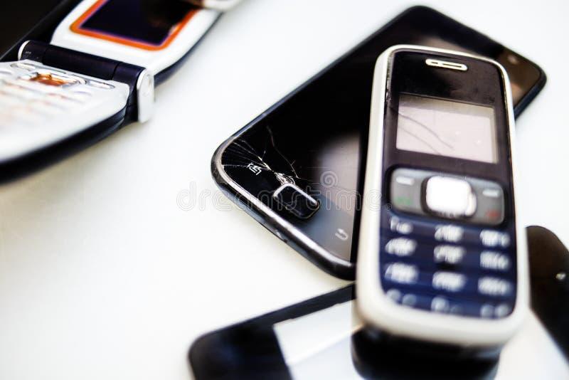 Broken telephones. Few broken telephones on the table stock photo