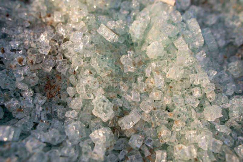 Broken tempered glass, green glass pieces stock photos