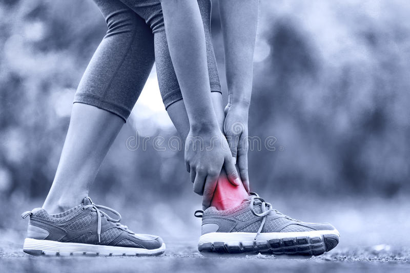 Broken twisted ankle - running sport injury stock images