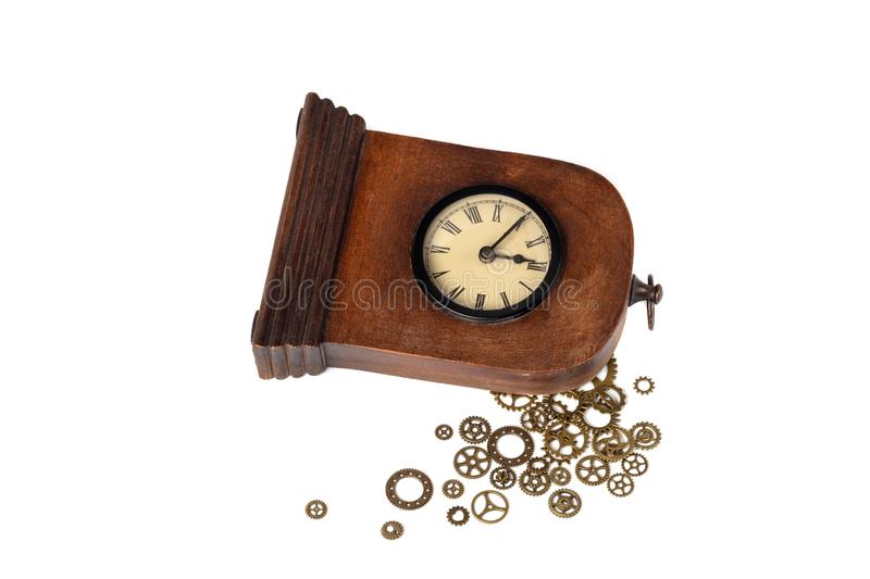 Broken vintage clock on white background. Clock gears outside.  stock photo