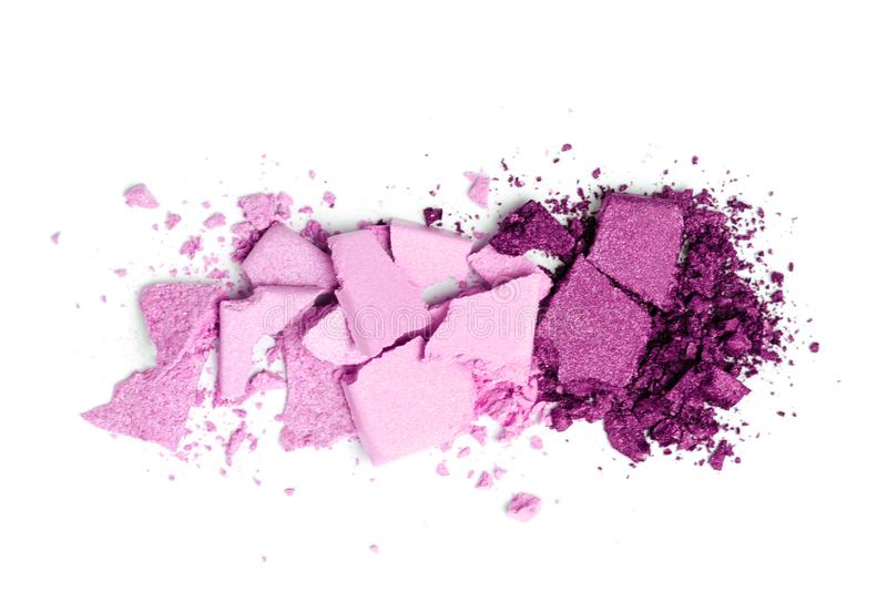 A broken violet eye shadow make up palette isolated on a white background stock photo