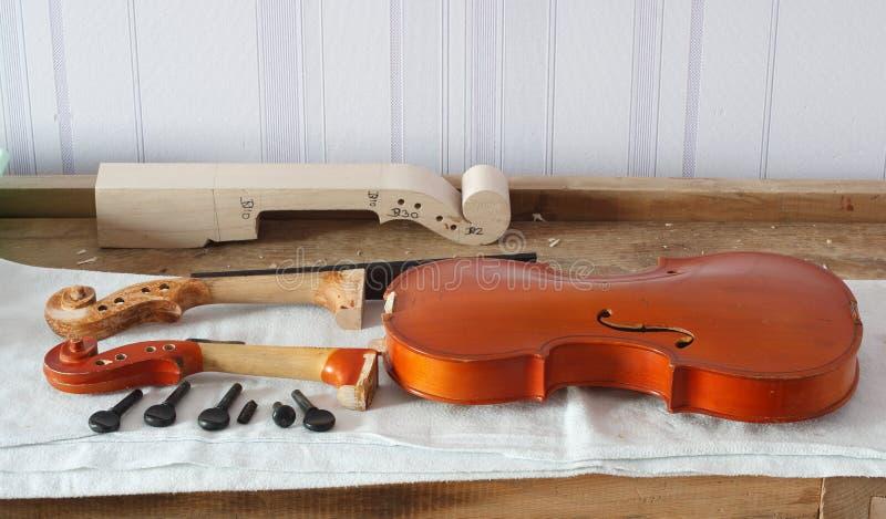Broken violin restoration stock images