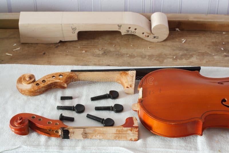 Broken violin restoration stock image