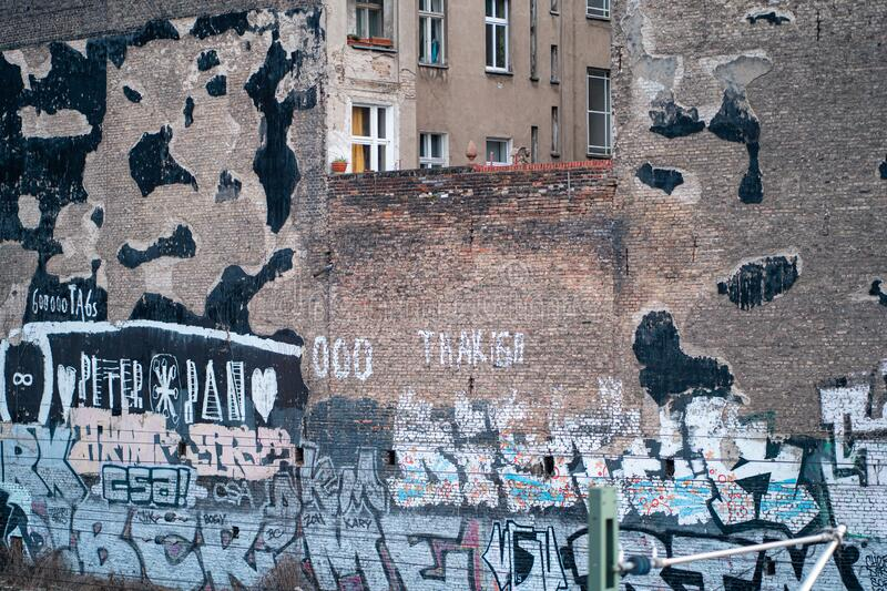 Broken wall in Berlin, Germany. Graffiti and old broken wall in Berlin, Germany royalty free stock photo