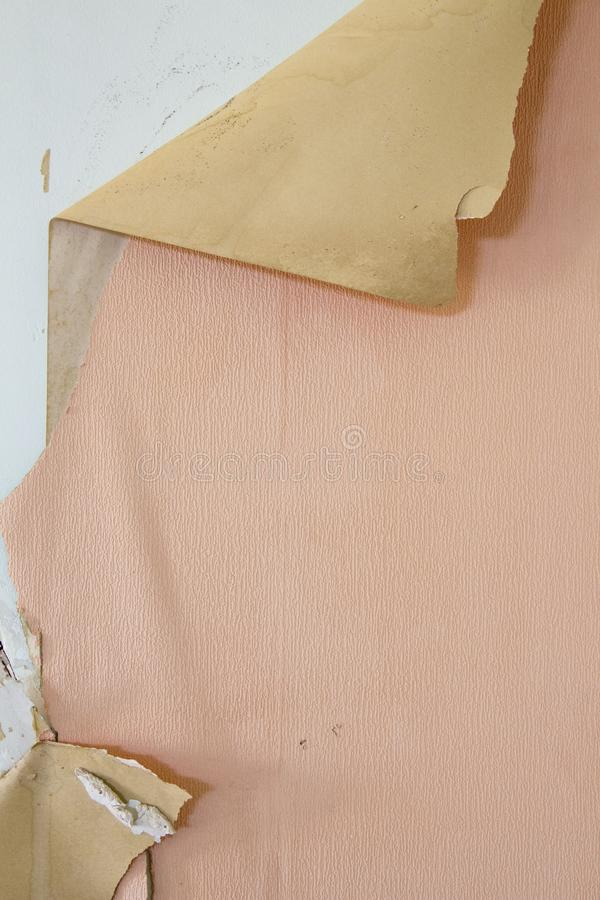 Broken wall paper salmon colored royalty free stock photography