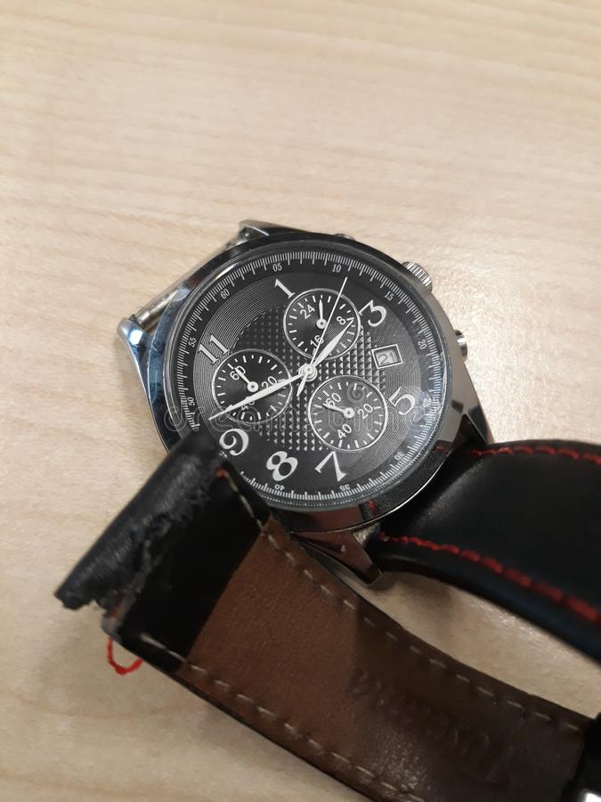 Broken watch strap. Broken old watch strap stock image