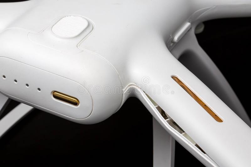 Broken white drone after a fall. Isolated on a black background. Damaged body close-up stock photography