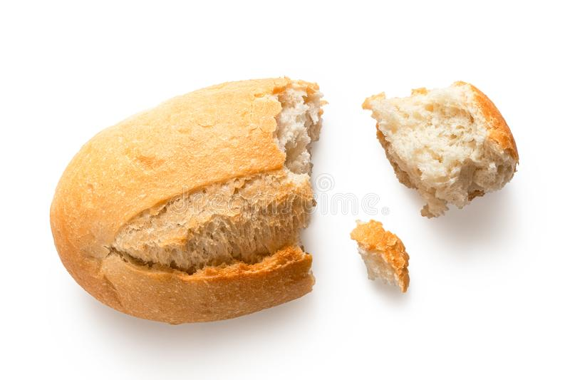 Broken white french bread roll isolated on white. Top view.  royalty free stock image