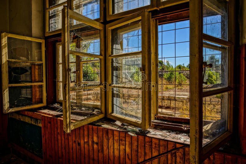 Broken window in abandoned house, HDR picture stock images