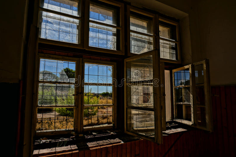 Broken window in abandoned house, HDR picture stock photography