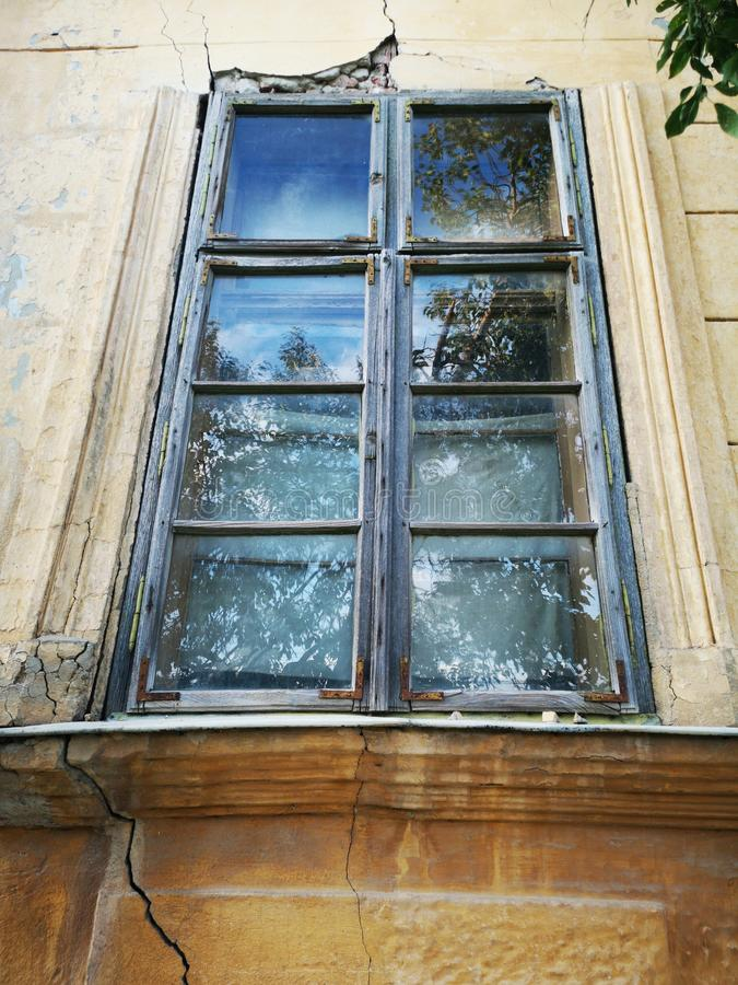 Broken window from abandoned house stock photo