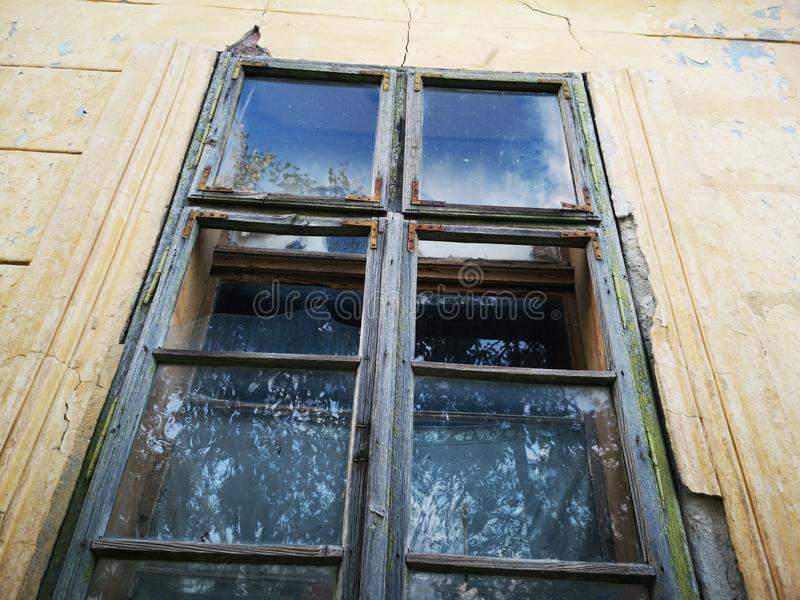 Broken window from abandoned house royalty free stock photo