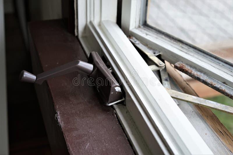 Broken window crank royalty free stock photo