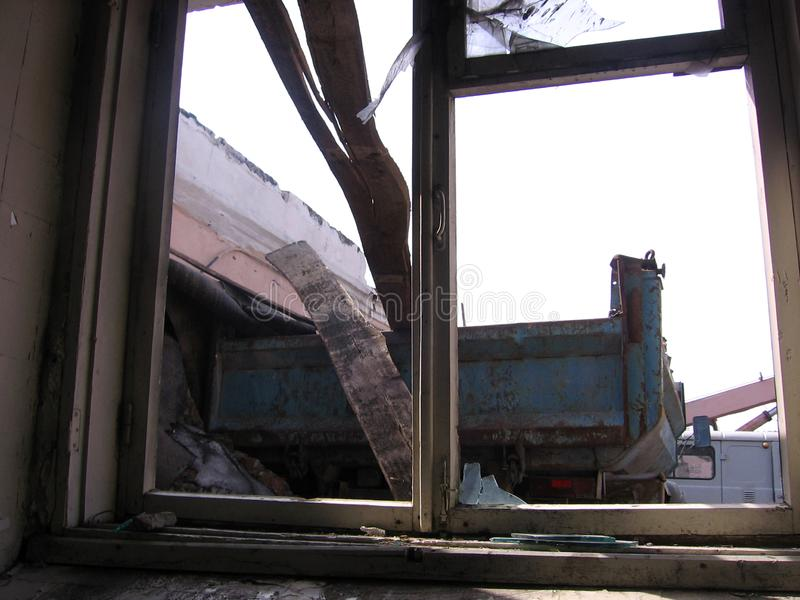 broken window broken frame in a ruined house royalty free stock photography