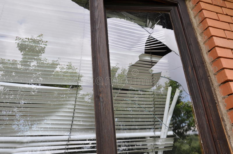 Broken window glasse. Right side of the window. Photo taken on: June 21st, 2015 stock photos