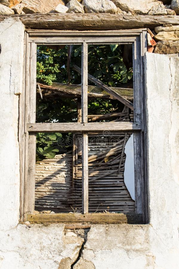 Broken window on old abandoned house. Ruin. Close up stock images