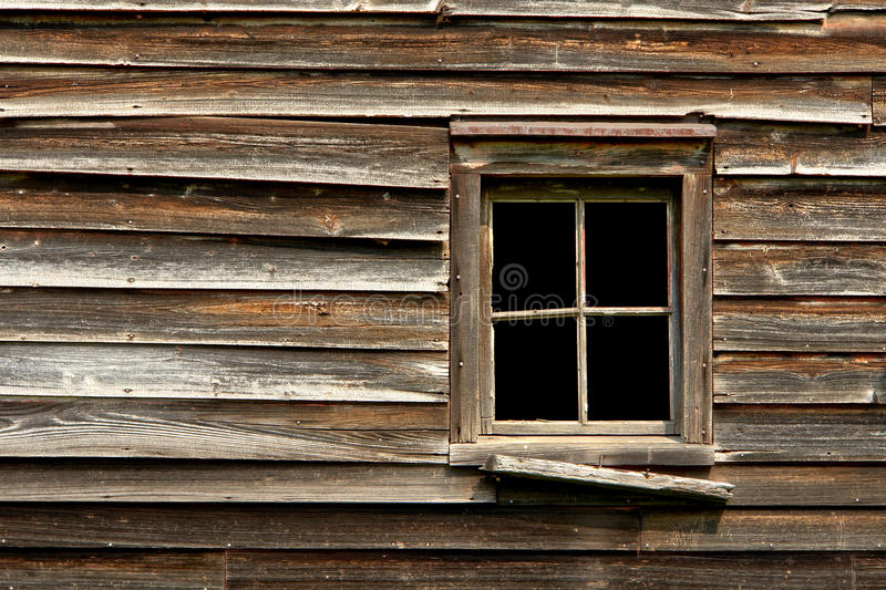 Broken Window On An Old Abandoned Wood House Stock Photo