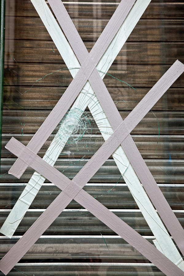 Broken window of shop stock image