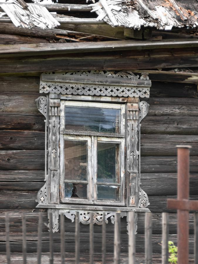 A broken window in a wooden house. stock image