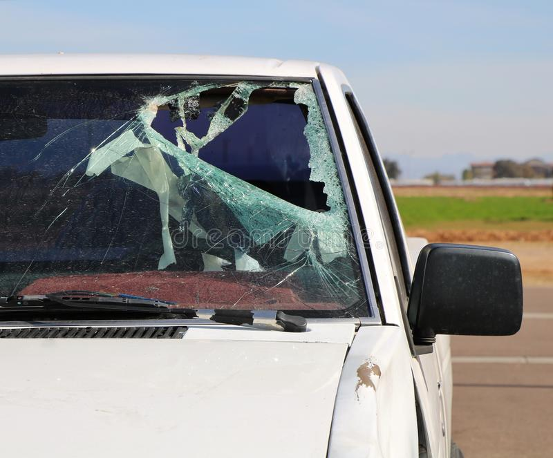 Broken Windshield in a Car Accident. A car with the broken windshield after a car accident stock images