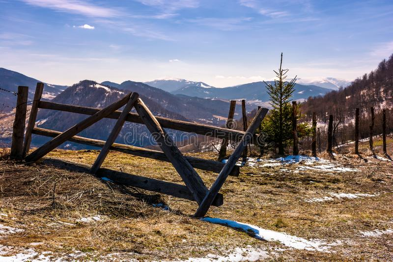 Broken wooden fence on hillside royalty free stock photo