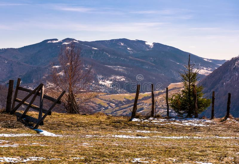 Broken wooden fence on hillside stock photos